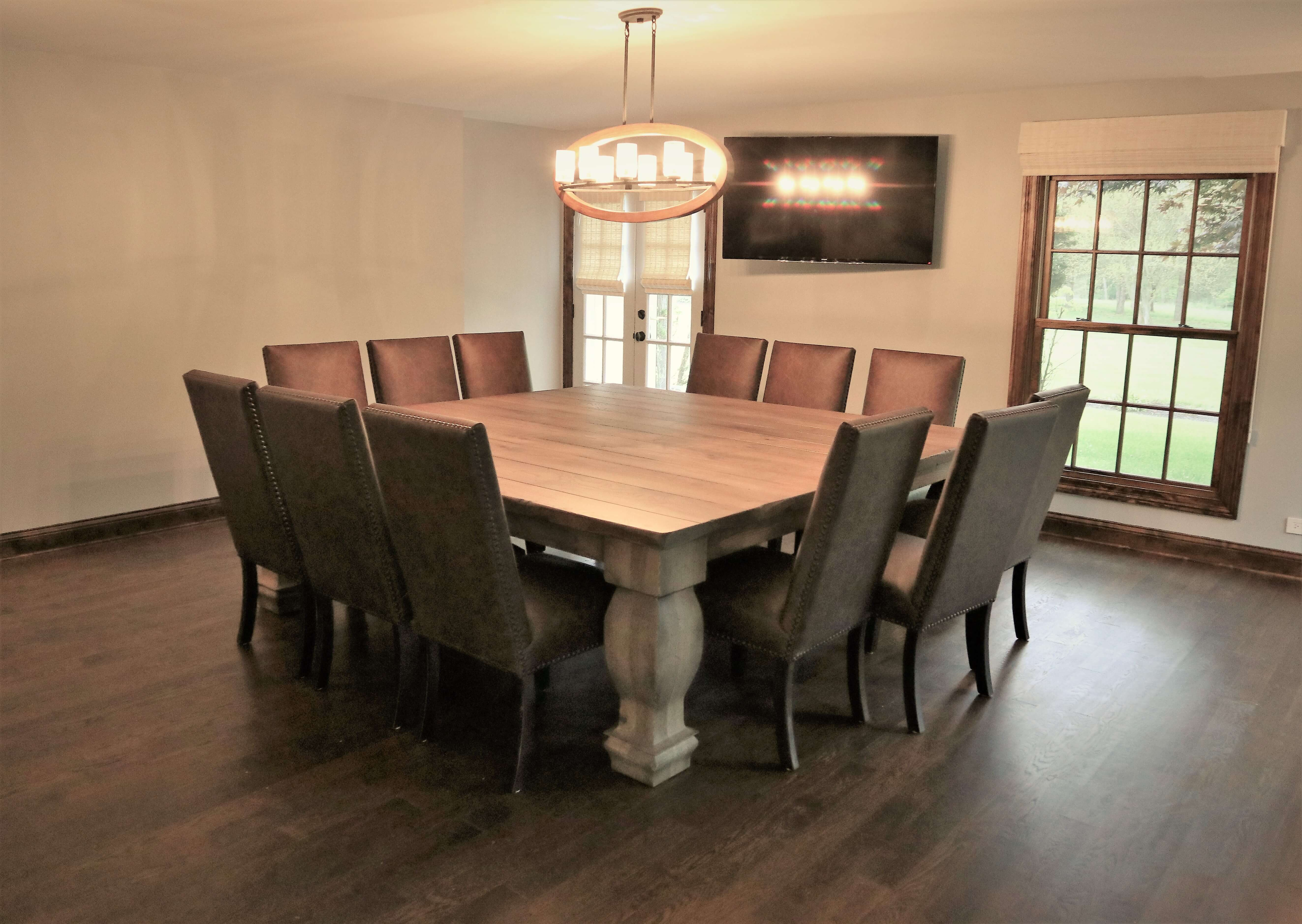 Traditional over-sized square tables with custom carved legs.