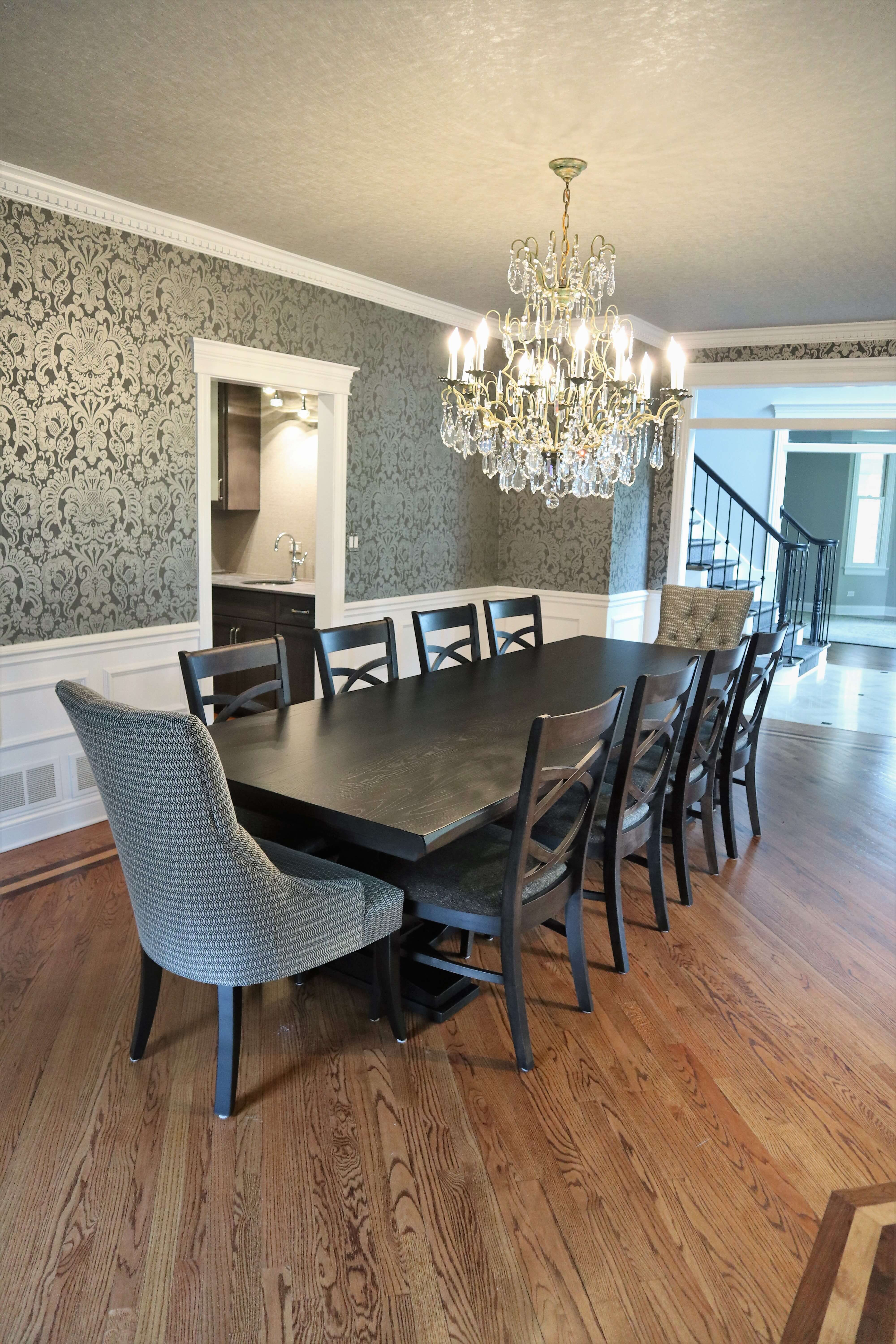 Black table rectangular tables with wood and fabric chairs.