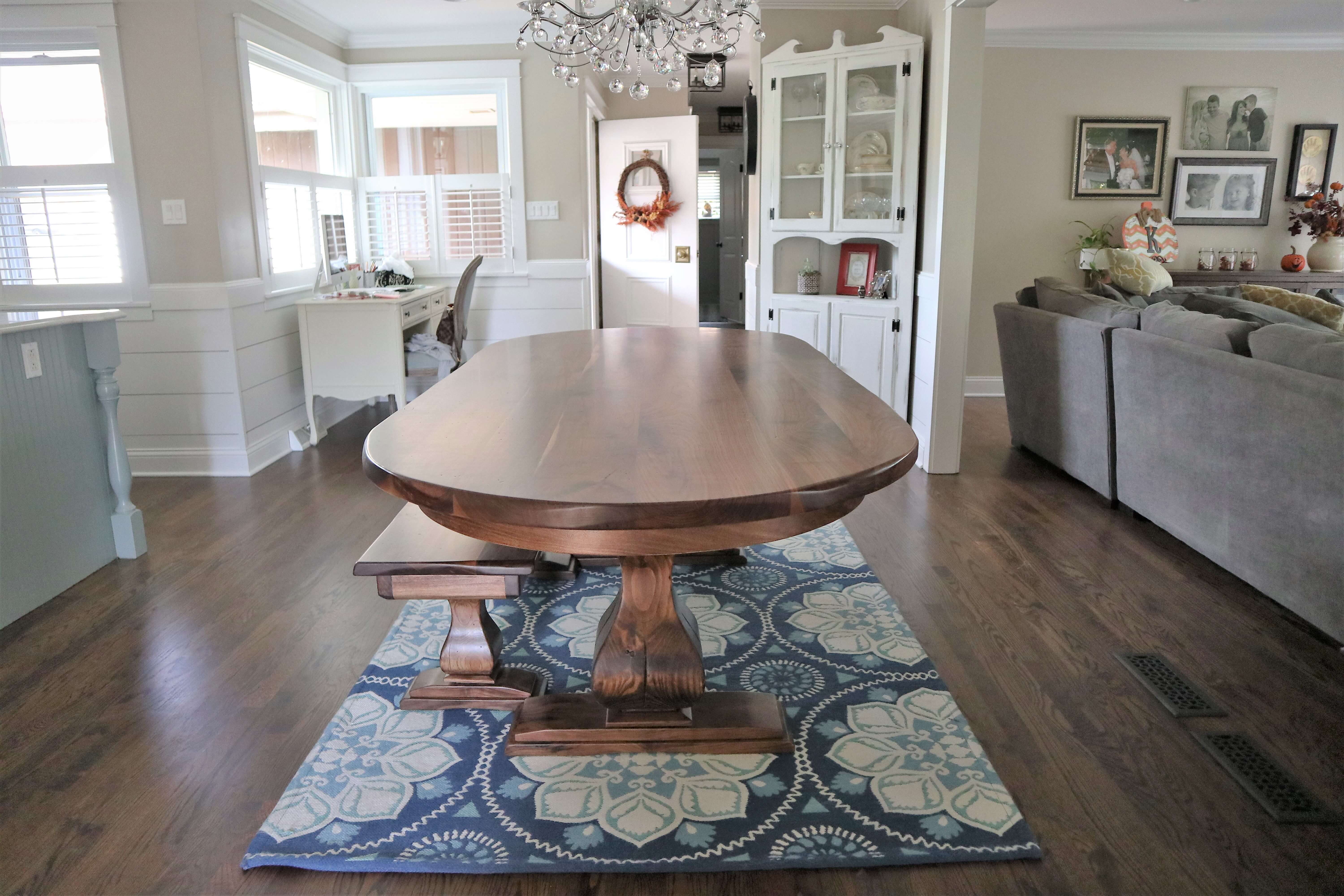 Solid walnut, oval tables with matching bench