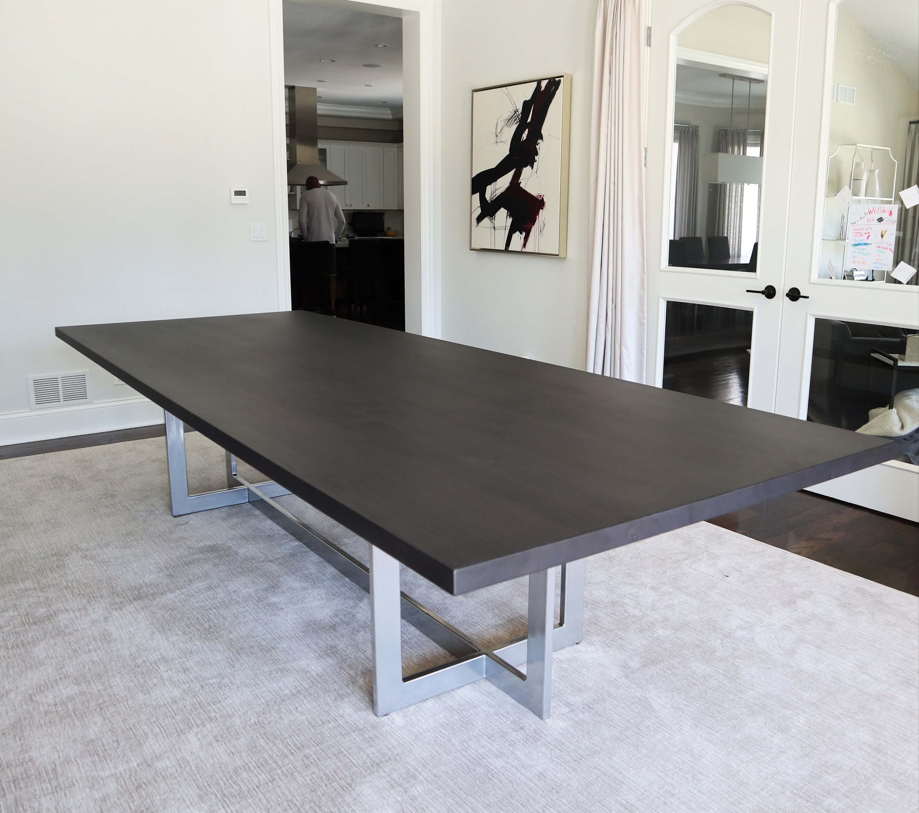 Custom tables made from metal with a wood top.