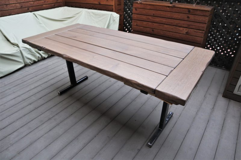 Outdoor table with metal base